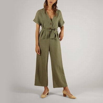 Green flared cut jumpsuit with rolled up sleeves and side pockets.