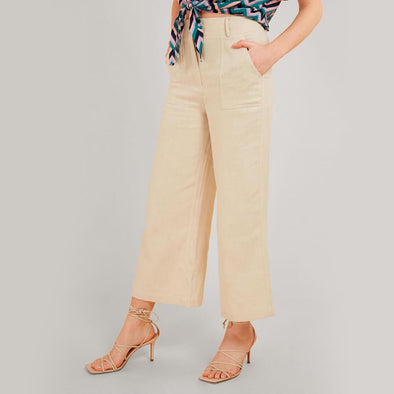 High waisted beige linen flared cut trousers with patch pockets.