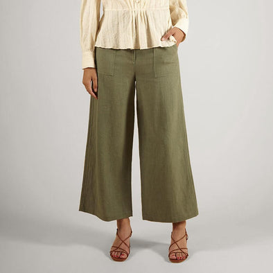 High waisted green linen flared cut trousers with patch pockets.