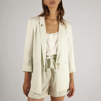 Elegant mint blazer with fake front pockets.