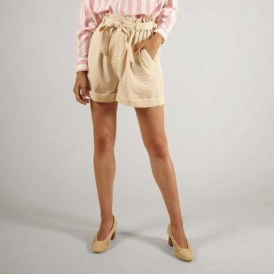 Beige high waisted paperbag shorts with side pockets.