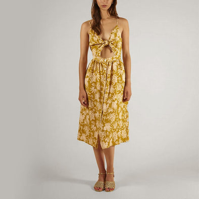 Midi dress featuring a mustard-coloured print and a bow at the front.