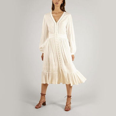 White midi dress with a V-neck and embroidered details.