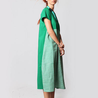 Green midi dress with short sleeves and a vichy pattern on the front.