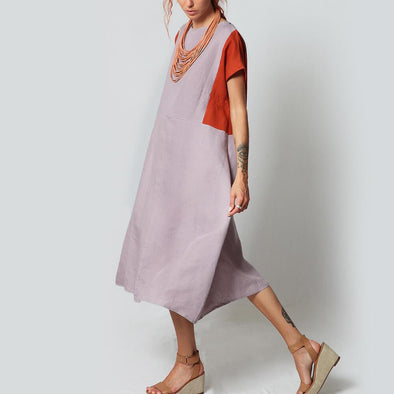 Light grey midi dress with orange and lilac details.