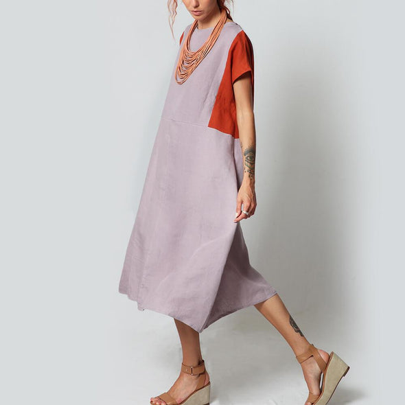 Lilac midi dress with orange and aubergine details.