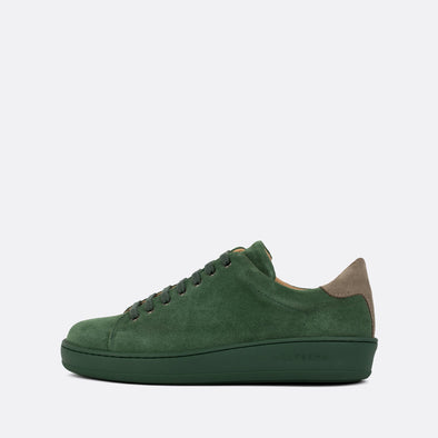 Casual green suede low-top sneakers with grey panels and green sole.