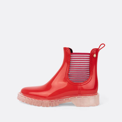 Red rain boots with transparency outsole.