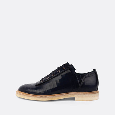 Navy blue oxford shoes with matching laces.