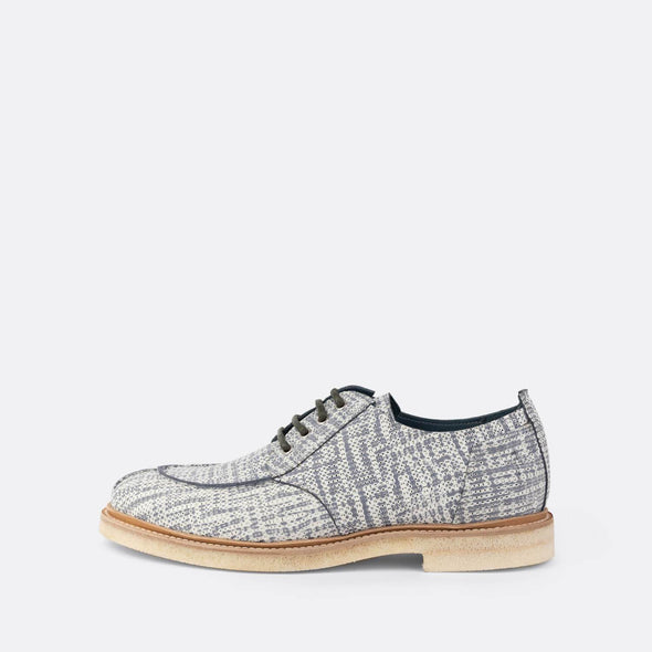 Patterned derby shoes with grey laces.