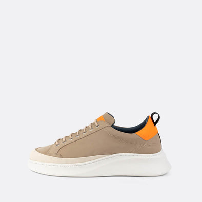 Beige leather runners with fluorescent orange leather detailing.