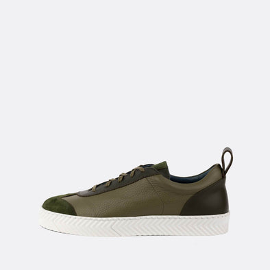 Retro low-top sneakers with green leather uppers with suede toe cap detail.