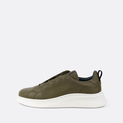 Olive green leather sneakers with a bold-sporty sole.