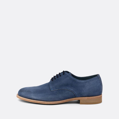 Blue derby shoes with lace-up closure and an almond-shaped toe.