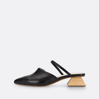 Sophisticated black mules with unconventional wooden heel.
