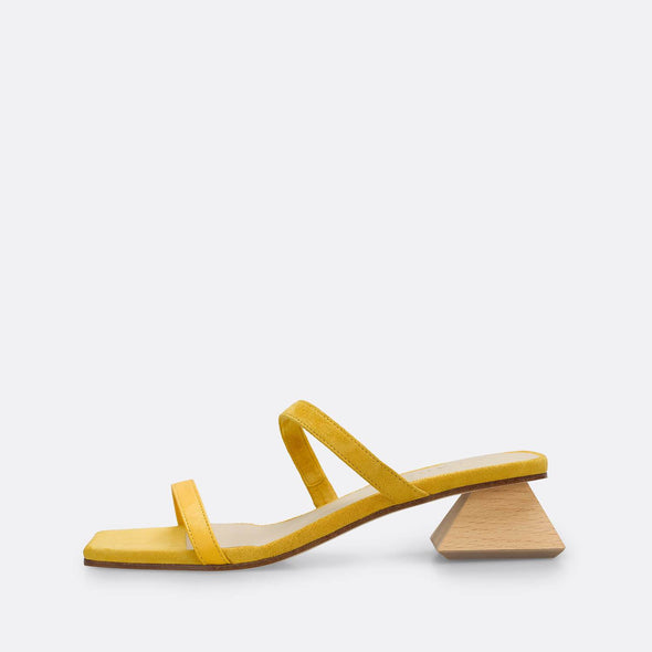 Mustard square toe strappy slides with unconventional wooden heel.