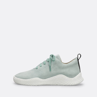 Mint leather sneakers with chunky white sole.