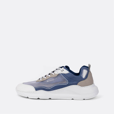 Multicolor runner sneakers in blue, grey and white tones.