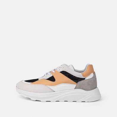 Multicolor runner sneakers in light orange, black, grey and white tones.