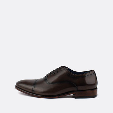 Dark brown leather oxfoard shoes with black laces.