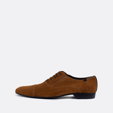 Caramel brown suede oxford shoes with dark blue heel detail and laces.