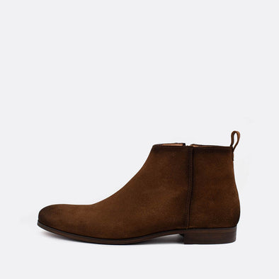 Brown suede boots with side zipper.