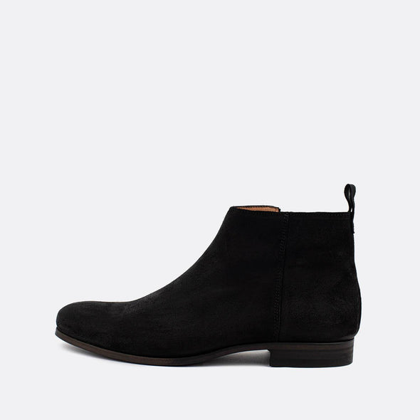 Black suede boots with side zipper.