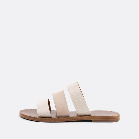 Flat slides with three nude straps, two in croc embossed leather and one suede.