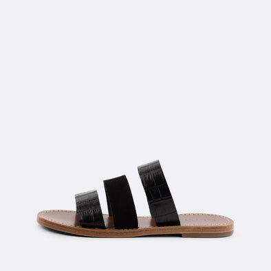 Flat slides with three black straps, two in croc embossed leather and one suede.