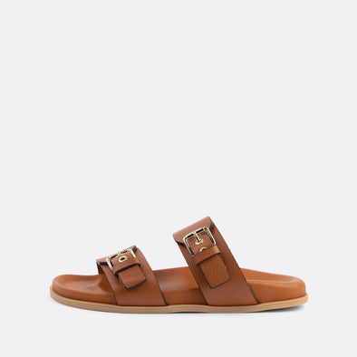Brown leather double-strap adjustable sandals featuring golden hardware.