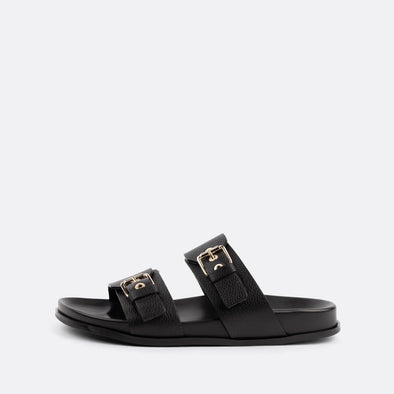 Black leather double-strap adjustable sandals featuring golden hardware.