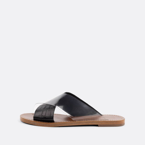 Flat slides with a cross-over strap in black croc embossed leather and vinyl.
