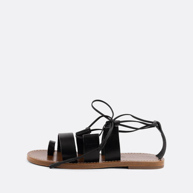 Black leather gladiator style flat sandals.