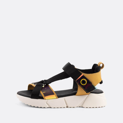 Multicolored sandals featuring velcro straps and a chunky sole.
