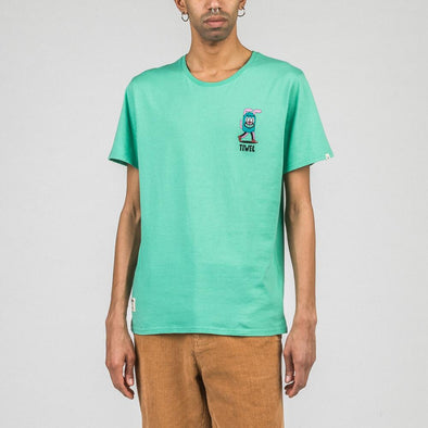 Green t-shirt with exclusive chest print by Yeye Weller.