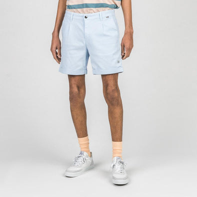 Light blue shorts.