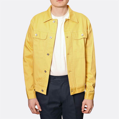 Yellow classic trucker jacket with a classic colla and two large chest pockets.