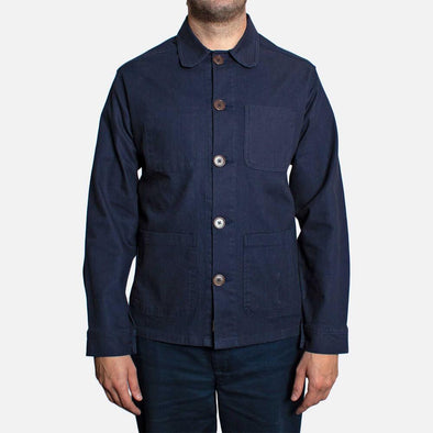 Navy blue workwear style overshirt/jacket with a rounded club collar.
