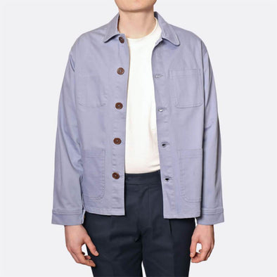 Light blue workwear style overshirt/jacket with a rounded club collar.