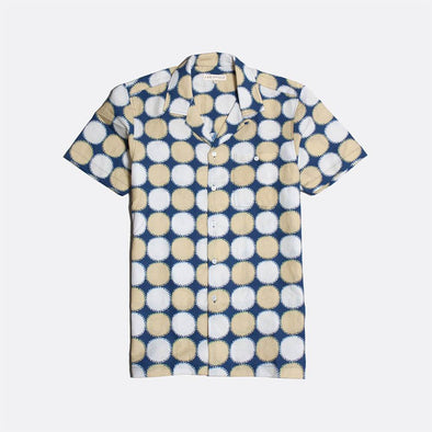 Blue short sleeved bowling shirt with white and beige all-over print.