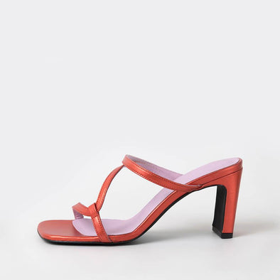 Metallic orange square toe sandals with thin straps across the front.