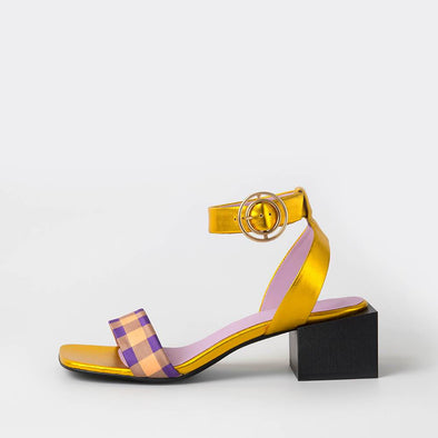 Square toe sandals featuring metallic leather, a strip of plaid satin fabric and a square black wooden heel.