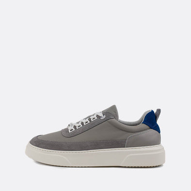 Grey textured sneakers with blue detail.