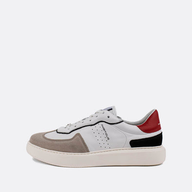 White leather sneakers with touches of red, blue and grey.