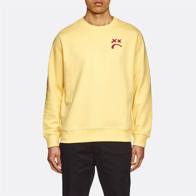 Soft yellow sweatshirt with a red embroidery on the left side.