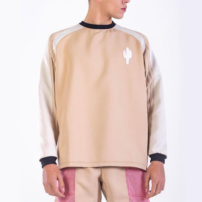 Camel sweater featuring a white leather cactus on the chest.
