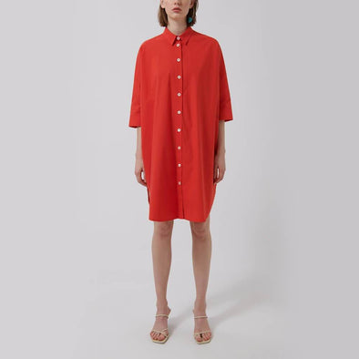 Red oversized shirt-style dress with 3/4 sleeve, front button closure and side openings.