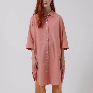 Rose oversized shirt-style dress with 3/4 sleeve, front button closure and side openings.