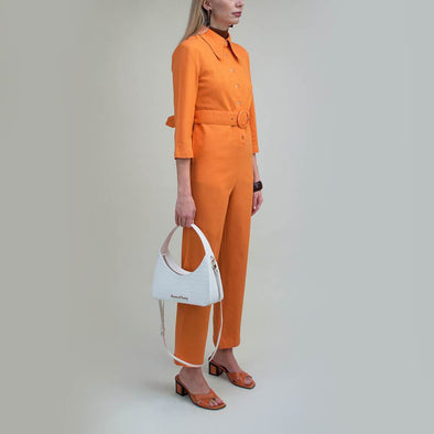 Orange wide leg jumpsuit with retro oval belt detail.
