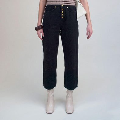 "Classic 90's black denim high waisted jeans with ""H"" and ""S"" embroidery."